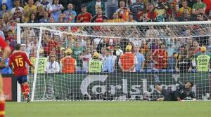 Spain's Ramos scores a goal against Portugal's goalkeeper Patricio during penalty shoot-out at their Euro 2012 semi-final soccer match at Donbass Arena in Donetsk