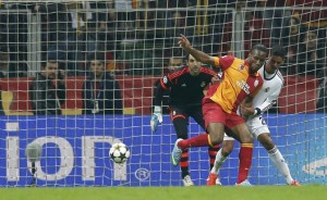 Galatasaray's Drogba scores a goal past Real Madrid's Varane and goalkeeper Lopez during their Champions League quarter-final second leg soccer match in Istanbul